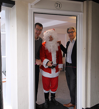 More Christmas office pictures - and here's Santa cutting the ribbon...