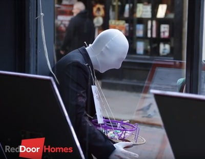 Frightful! Hooded agent gives passers-by the shock of their lives…